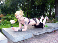 Young woman throws erotic photo session on graveyard