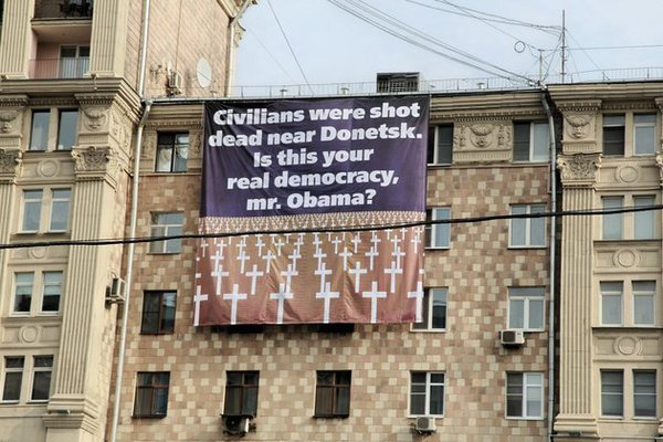 The cowardly and despicable American presstitutes. Students hang banner in front of US Embassy in Moscow