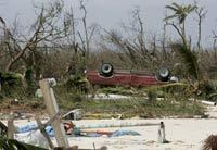 Hurricane Dean weakens, hits Mexico's oil platforms