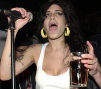 Amy Winehouse's home under raid of police
