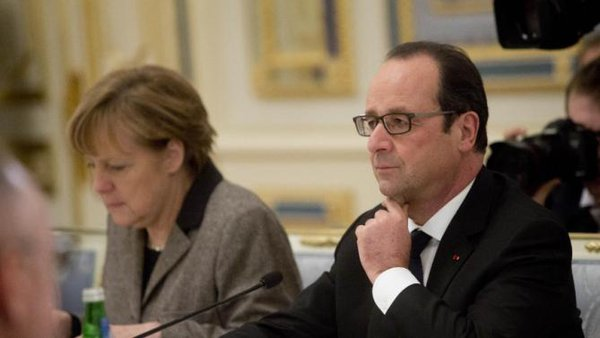 Merkel and Hollande conduct face to face talks with Putin in Moscow Kremlin. Angela Merkel and Francois Hollande