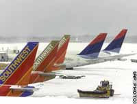 British airports dig out after heavy snowfall