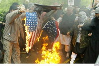 Vandals burn dozens of small American flags at cemetery