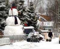 Giant Snowzilla rises even bigger in Alaska neighborhood