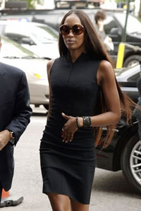 Naomi Campbell Hits Her Driver from Behind