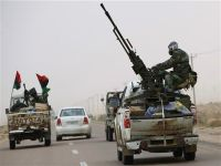 NATO discusses restructuring and war against Libya. unarmed civilians