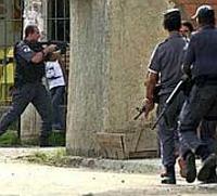Brazilian drug gangs burn buses and shoot police officers, killing 19