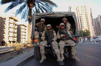 American troops fire on bus,carrying Iraqi bank employees;4 people killed