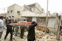 Rescuers search for bodies under remains of UN offices in Algiers bombed by al-Qaida affiliate