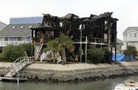 Beach house packed with students burns completely, 7 killed