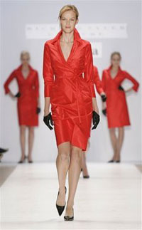 Some NWA flight attendants want to wear red dress uniform