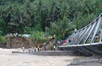 Suspension Bridge Collapses in Indonesia during Religious Ceremony, 12 Children Killed