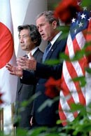 Bush taking Japanese Prime Minister Koizumi to Elvis' home Graceland
