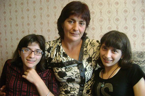 Zita and Gita: World's only successfully separated Siamese twins lose each other for good. Zita and Gita with their mother