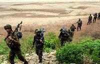 Indian security forces battle suspected militants in Kashmir