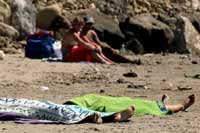 Italy shocked with photos of beach-goers sunbathing near dead bodies of drowned girls