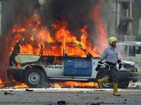 Suicide car bombers hit police patrols