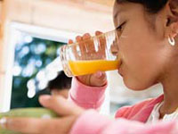 Toddler drinks orange juice with cleaning fluid