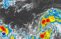 Storm-soaked Carolinas under hurricane watch as Ernesto nears; Virginia declares emergency