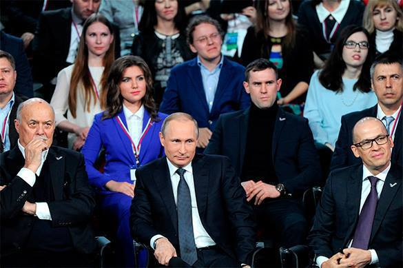 Putin works as translator from German at public meeting. 57738.jpeg