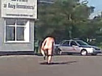 Russian police officers run away from naked man