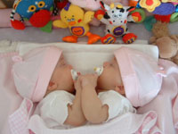 Two-year-old twin girls who were conjoined at the chest and