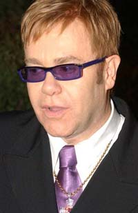 Elton John confirms police seized his photo