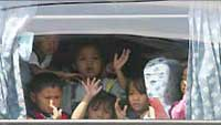 Dozens of children play with dolls, lick ice cream during Manila hostage crisis