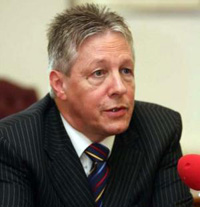 Peter Robinson Withstands the Clamor Over Scandal