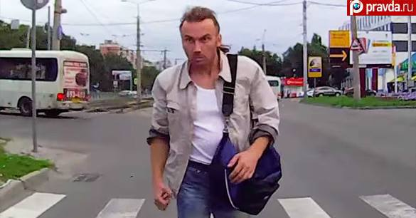 Aggressive passerby stops moving car with his angry look and iron fist. Video. 58808.jpeg