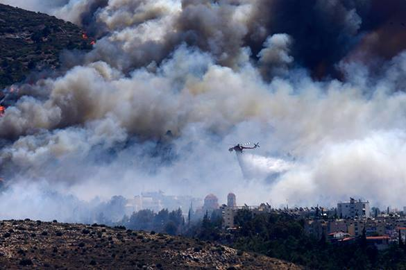 Southern Greece evacuated over fire. Greece