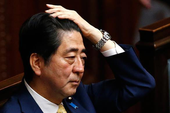Japanese PM approval rating drops record low. Shinzo Abe