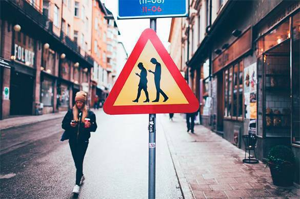 'People with smartphones' traffic signs appear in Stockholm. People with smartphones