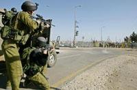 Israeli soldiers surround Hebron house