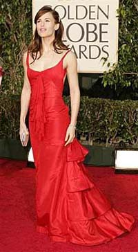 White and metallic gowns dominate a relaxed red carpet at the Golden Globe Awards