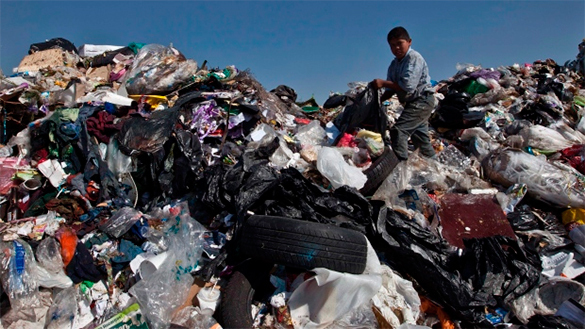 Social costs of capitalism destroy Earth's ability to support life. Earth: Planet of garbage