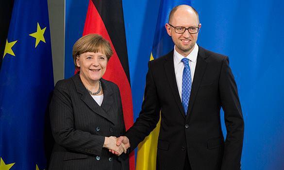 Ukraine's Yatsenyuk prepares Germany for USA's war. Yatsenyuk in Germany