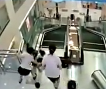 Woman saves her child while being sucked into moving escalator in China. Video. Woman killed in escalator