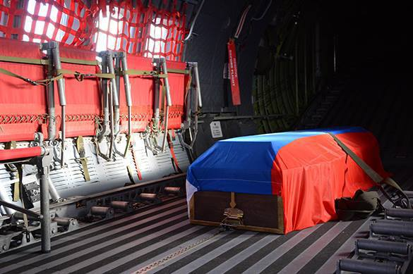Russian pilot killed by Turkish Air Force buried with honors. Russian pilot buried