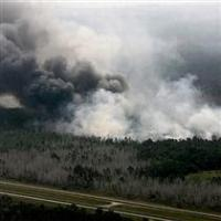 Massive wildfire jumps containment line along the Georgia-Florida border