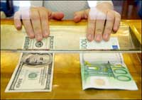 Euro slightly down against U.S. dollar