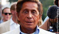 Designer Valentino leaves