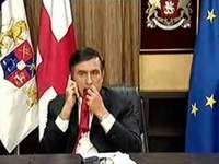 Georgian President Saakashvili eats his tie on TV live (video)