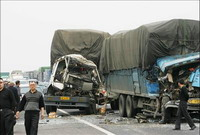 Highway pileup of dozens of vehicles kills at least 2 people