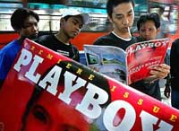 Islamic protesters hurl abuse at Indonesia's first Playboy centerfold model
