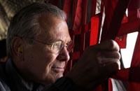 Elections, Rumsfeld exit open door to change for Iraq but politics could shut it