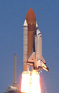 Space shuttle moved to pad as NASA aims for earlier launch