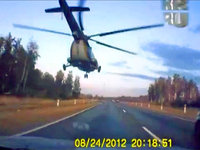 Crazy helicopter terrifies drivers in Russia. 47938.jpeg