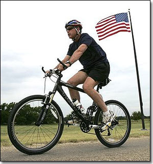 Bike rider Bush exhorts people to commit to exercise