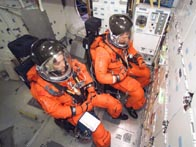 Spacewalking astronauts lose bolt and spring